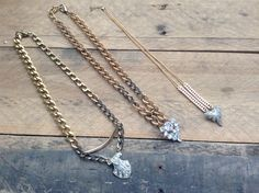 Vintage shoe clips and vintage brass chain necklaces. ONE OF A KIND! vervejewelry.com