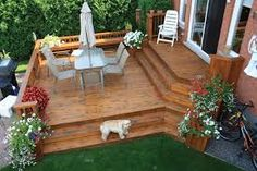 2 tier deck idea - I like the built in bench on the far side but steps down might be more practical.