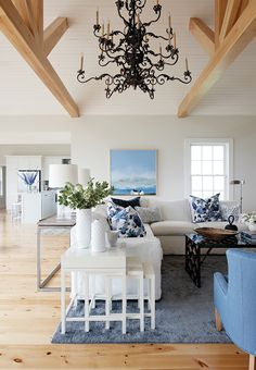 This living room by Sarah Richardson Design emphasizes the East Coast saltbox home's sea-inspired blue and white palette. A soaring ceiling accommodates the two-tiered wrought-iron chandelier, which s Sarah Richardson, Cottage Living Rooms, Coastal Living Rooms, Living Room Decor, Coastal Homes, Coastal Cottage, Coastal Country, White Cottage, Blue Rooms