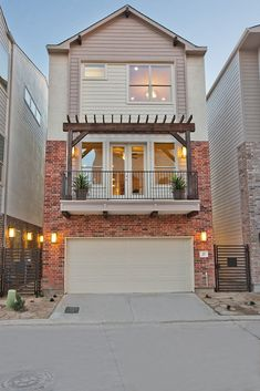 David Weekley Homes is an experienced home builder in San Antonio. House Front Design, Small House Design, Townhouse Exterior, Narrow House Designs, Townhouse Designs, Tiny House Cabin, Dream House Plans, Facade House, Building Design