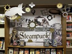 Steampunk - A subgenre of science fiction and fantasy featuring advanced machines and other technology based on steam power of the century and taking place in a recognizable historical period or a fantasy world. Teen Library Displays, Teen Library Space, Library Work, School Displays, Classroom Displays, Classroom Decor, Library Ideas, Library Design, Middle School Libraries