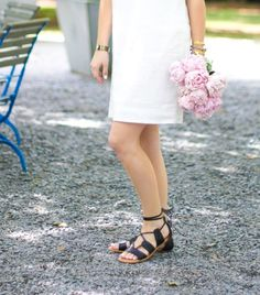 GlamGrace - By Tabby Black gladiator sandals with lace up tie, pink peonies and summer linen dress.