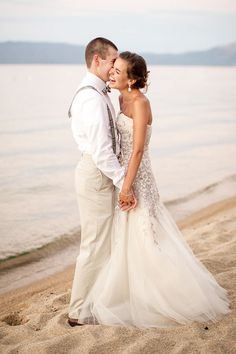 Dancing on the Beach | A beach wedding shot by Mike Larson Photography | http://heyweddinglady.com/chic-lake-tahoe-wedding-beach/