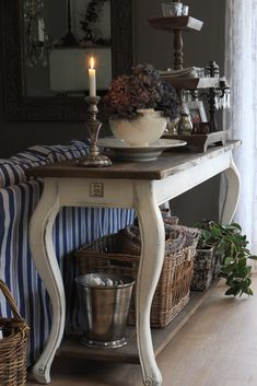 The sofa table . . . vignette is beautiful as well.