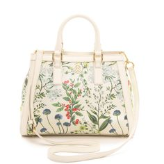 Tory Burch Robinson Printed Canvas Triangle Tote - Watercolor Botanical Print and other apparel, accessories and trends. Browse and shop 11 related looks.