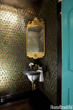Antique Georgian mirror, custom peacock-feather wallpaper, Henry sink by Waterworks.