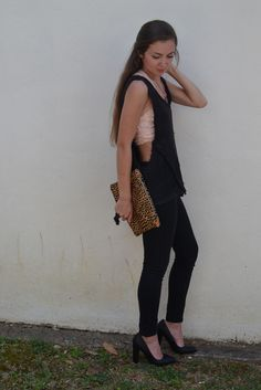 Low cut muscle tee inspired tank looks adorable paired with a blush bandeau, some black leggings, black heels, and a cheetah clutch. #ootd- Studio 3:19