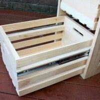 Have you seen the wooden crates that Home Depot sells? My husband and I used four of them to make a filing cabinet style storage piece. The crate drawers slid… Diy Storage Cabinets, Diy File Cabinet, Storage Cabinet With Drawers, Diy Drawers, Sliding Drawers, Filing Cabinets, Wooden Crates Crafts, Crate Crafts, Wood Crates