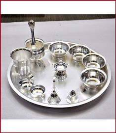 This puja thali set has 12 products. This Diwali buy our beautiful puja thali set to place puja items. Gold Jewellery Design, Silver Jewelry, Gold Pendant, Pendant Jewelry, Silver Pooja Items, Silver Lamp, Ornaments Design, Silver Accessories, Miniture Things