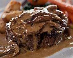 Steak Diane ~ The luscious cognac cream sauce with grilled mushrooms is absolutely gorgeous and served over a perfectly cooked Filet Mignon, with potato dauphinoise Steak Diane Sauce, Sauce Steak, Steak Diane Recipe, Mortons Steak, Filet Mignon Sauce, Sauce Recipes, Cooking Recipes, Stuffed Mushrooms, Stuffed Peppers