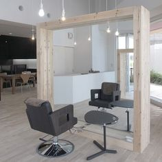 Customers sit at large wooden frames in this hair salon by Japanese studio Three.Ball.Cascade in Chiba, Japan. Called Luce Hair, the salon is divided by the wooden structures, some of which contain mirrors to create work stations while others remain empty, framing the space. Here's some more information from the designers: Kashiwa hairdresser Local development
