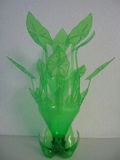 Water Lilly leaves and stems cut out of a large Plastic Soda Bottle. Mountain Dew soda bottles would work well for this cause it already green.Cut the bottom off and cut out the stems and leaves.