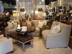 Houndstooth sectional sofa, leather tufted bench, fur throw, patterned accent pillows, jewel crystal accent lamps, wool shag floor rug antlers and Candles equals winter Luxe.