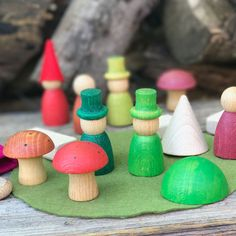 Grapat's Nins in the Woods Storytelling Set. Peg people, mushrooms, and other wooden and felt pieces make this an evocative set for play and storytelling