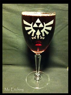 Legend of Zelda designs on lead crystal wine glasses.  Game with class people.