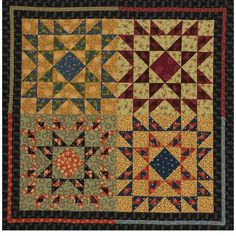 Four Corners Quilting Project This square quilt wall hanging uses a black print to frame a quartet of blocks. The colors and patterns combine to create a country home decor feel.