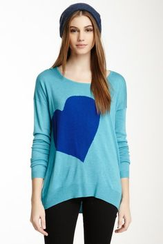 "Heart Hi-Lo Sweater by Vertical Design Sweaters  - Crew neck - Long sleeves - Front knit print - Approx. 25"" shortest length, 28"" longest length - Imported Additional Information Fit: this style fits true to size. Machine wash Fiber Content 75% rayon, 25% nylon $98"