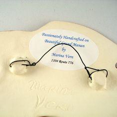 Attachment to hang ceramic art