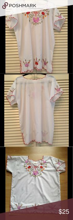 """Beautiful Embroidered Short Sleeve Blouse - White White Short Sleeve Blouse with Red Thread Trim around Neck, Arms and Scalloped Edge Bottom (with Side Slits)  Embroidered Flowers on the Front along Neckline and Bottom, as well as, on Top of the Sleeves  Trip to Mexico or East Europe!  65%  Cotton 35%  Polyester Machine Wash - Cold  Made in Mexico Originally purchased in San Antonio at the El Mercado, the Historic Market.  I believe the """"44"""" is size - European 44 is equivalent to US size 14…"""