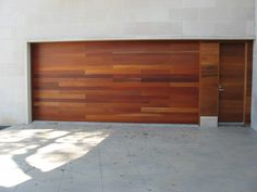 Wood Garage Door Custom Wood Doors Overhead Door Company Of Houston Design Garage Doors For Sale, Custom Garage Doors, Garage Door Panels, Garage Door Company, Carriage Garage Doors, Diy Garage Door, Modern Garage Doors, Custom Wood Doors, Wood Garage Doors