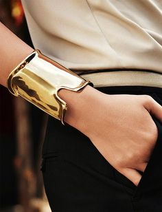 I got to have two of these, then I really would be wonder women!! Love this!!.Sculptural cuff