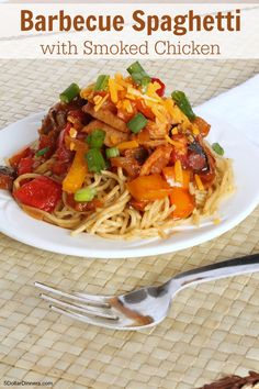 Barbecue Spaghetti with Smoked Chicken ~ amazing smoked chicken doused in BBQ sauce and mixed with a bunch of fresh summer veggies, then topped with cheddar cheese and piled high over a plate of pasta. | 5DollarDinners.com