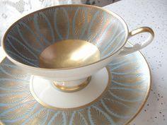 antique German tea cup and saucer set, vintage 1940's Alka Kunst Bavaria porcelain tea set, blue and gold tea cup, art deco tea cup. $45.00, via Etsy.