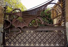 This iron gate with a mythical dragon was designed by Antoni Gaudi. It's located in the Pavellons Güel.