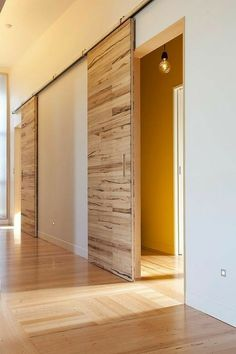 INTERIOR- The doors provide privacy and reduce noise between premises. If it comes to a smaller space, sliding doors are suitable option, because the opening and closing take up less space than con… Sliding Door Design, Sliding Barn Door Hardware, Door Latches, Sliding Wall, Design Innovation, Barn Style Doors, The Doors, Entry Doors, Patio Doors