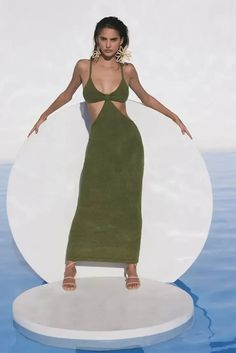 The Cult Gaia Serita is a cutout woven knit maxi dress. Thoughtful cutouts shape your figure, highlighting the small of your waist. A bra silhouette with a bare all open back. Pair with the Banu Bag and bare feet and you're ready for a night of dancing on the beach. This dress is worth all the Instagram hype! | Designer Dress | Knit Maxi Dress | Cutout Maxi Dress | Resort Dress | Resort Outfit | Wedding Guest Dress | Sexy Maxi Dress | Designer Summer Outfit | Beach Wedding Guest Outfit | Cruise Dress, Cruise Outfits, Date Night Dresses, Dresses For Work, Summer Dresses, Wedding Rehearsal Dress, Resort Wear For Women, Resort Dresses, Dress The Population