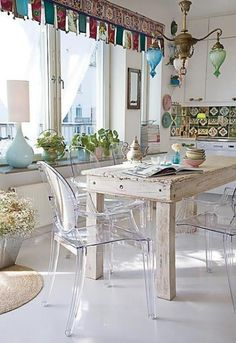 love the flags as curtains and the rustic table with clear chairs