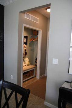 foyer - turn a coat closet into a coat storage + boot-dressing area