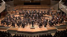 "Berlin Philharmonic Orchestra performing Carl Nielsson's Symphony No. 4, ""The Inextinguishable,"" featuring a timpani battle among two timpanists during the final movement."
