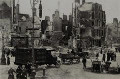 Photograph, shows a Jacob's lorry making its way through the rubble after the 1916 Easter Rising. Ireland 1916, Dublin Ireland, Old Pictures, Old Photos, Military Police Army, Easter Rising, Ireland Homes, African American History, Historical Photos