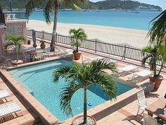 Enjoy the beautiful beachfront at The Villas On Great Bay