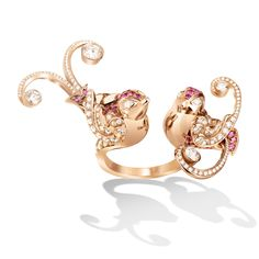 Van Cleef & Arpels Oiseaux de Paradis collection was inspired by the Bird of Paradise. Whimsical, happy birds perch cheerfully between the fingers set in pink gold with diamonds and pink sapphires