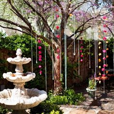 The couple exchanged vows in their own backyard. Crystal and fresh flower garlands defined the ceremony space around them.