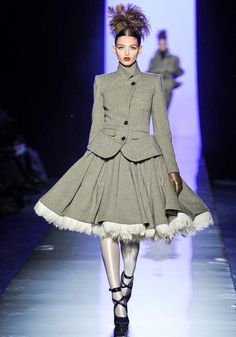 Jean Paul Gaultier FW11- contemporary style of suit with the outlines if the hoops underneath the skirt, inspired from the Crinoline period.