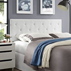 Terisa Queen Vinyl Headboard In White - MOD-5369-WHI Free ShippingDescription:Enhance your decor with the distinguished Terisa Headboard in Vinyl. Magnificently adorned with deep button tufting and a diamond-patterned trim, Terisa comes finely upholstered, has a solid wood frame, adjustable black coated metal legs, and dense foam padding for ultimate support. Rejoice with a contemporary design that exceptionally compliments your bedroom decor. Fully Compatible with Sharon, Sherry and Helen…