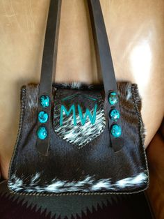 """Custom """"Little Big Bonnie"""" bag with turquoise suede MW brand on the flap. Six turquoise stones line up on the leather straps. Sold to my new friend in Canada."""