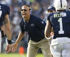PENN STATE – FOOTBALL 2014 – Penn State head coach James Franklin celebrates with his team after running back Zach Zwinak's touchdown run during the second quarter at Beaver Stadium on September 20, 2014. The Lions beat the Minutemen, 48-7. Joe Hermitt, PennLive