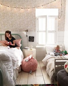 Anissa Zajac children's bright bedroom with vintage twin beds and eclectic wallpaper
