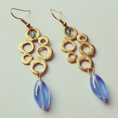 Check out this item in my Etsy shop https://www.etsy.com/uk/listing/470010188/wonderful-in-blue-dangle-earrings-tear
