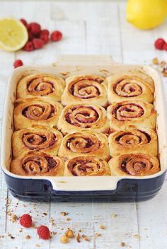 These raspberry hazelnut rolls are sticky, fluffy and topped with a deliciously sweet lemon glaze | emnzest.com