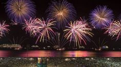 Jan. 1, 2015: People watch fireworks exploding over Copacabana beach during New Year celebrations in Rio de Janeiro, Brazil. (AP)