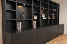 Hand painted black display shelves made of veneered wood. Built in London UK Designed and built by www.EMPATIKA.uk