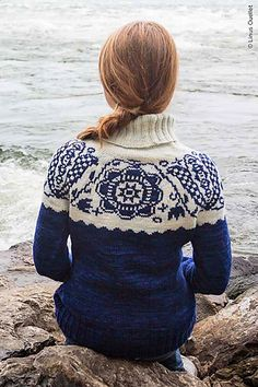 The pullover is worked from the top down, starting with the turtleneck. The back neck is shaped with short rows. The yoke increases are incorporated in the charted pattern.