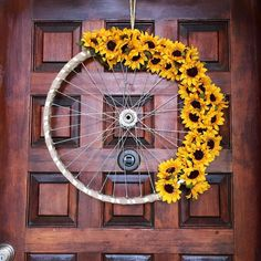 Sunflower bike wheel wreath #texasrusticwooddecor #sunflowers #fallfloral #fallwreath #bikewheelwreath #bikewheel #bicyclewheel #upcycled #fall #autumn #etsy #etsyshop #shopsmall #etsyseller #shopetsy #etsyhunter