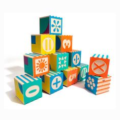 Groovie™ Math Blocks - Teach your littles one to sort, order, and recognize patterns and opposites in style. Made from sustainable Michigan bassword, this set from Uncle Goose contains 28 colorful blocks with debossed numbers, mathemetical symbols, and geometrical shapes that correspond to a number on the opposite side. | Dwell