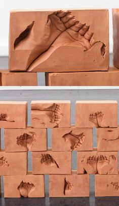 Artist Dan Stockholm imprinted his hands in #redclaybricks. #sculpture #installationart #claysculpture